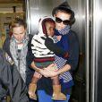 Charlize Theron, son fils Jackson et sa maman Gerda arrivent à l'aéroport de Los Angeles le 6 janvier 2013.