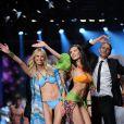 Karolina Kurkova et Marica Pellegrinelli défilent en bikini pour Yamamay à Milan. Le 19 février 2013.