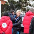 La princesse Mette-Marit de Norvège à Holmenkollen (Oslo) le 17 mars 2012 avec son fils le prince Sverre Magnus dans les bras.