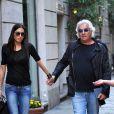 Flavio Briatore et sa femme Elisabetta Gregoraci, couple complice à Milan le 18 avril 2013