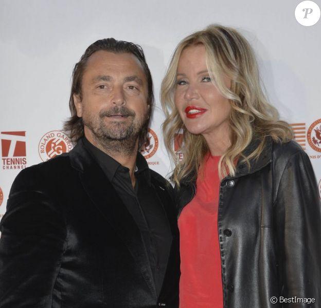 Henri Leconte et sa femme Florentine lors de la soirée des joueurs de Roland-Garros à la Résidence de l'Ambassadeur des Etats-Unis à Paris le 24 mai 2013