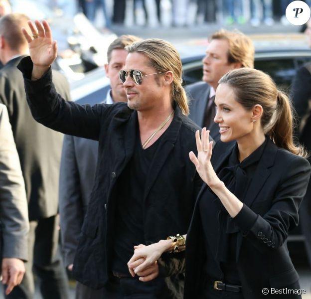 """Brad Pitt et Angelina Jolie arrivant à l'avant-première du film """"World War Z"""" à Paris sur les Champs-Elysées le 3 juin 2013"""