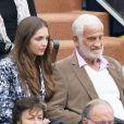 Jean-Paul Belmondo et sa jolie petite fille Annabelle assistent au 8e sacre de Rafael Nadal lors des Internationaux de France à Roland Garros à Paris le 9 juin 2013.