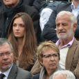 L'acteur Jean-Paul Belmondo et sa petite fille Annabelle assistent au 8e sacre de Rafael Nadal lors des Internationaux de France à Roland Garros à Paris le 9 juin 2013.