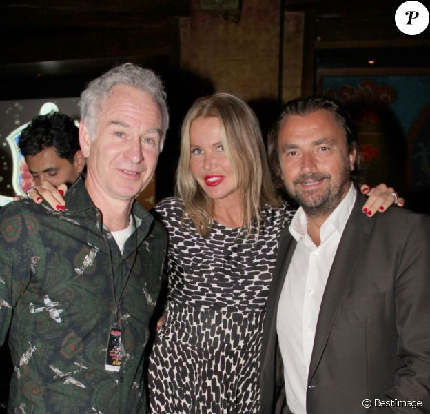 John McEnroe, Henri Leconte et sa femme Florentine lors du dîner du Trophée des Légendes au Buddha-Bar à Paris le 5 juin 2013