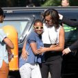 La first lady Michelle Obama et ses filles Sasha et Malia arrivent pour leur visite du Mémorial de l'Holocauste à Berlin, le 19 juin 2013.