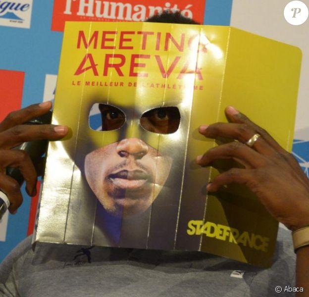 Usain Bolt, héros masqué du Meeting Areva, fidèle à lui même lors d'une conférence de presse. Paris, le 2 juillet 2013.