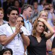 Amélie Mauresmo et Thomas Drouet lors de la demi-finale de Wimbledon qui opposait Marion Bartoli à Kirsten Flipkens le 4 juillet 2013 à Londres
