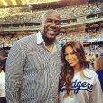 Nicole Scherzinger et Magic Johnson le 31 juillet 2013 lors d'un match des Dodgers de Los Angeles