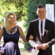 Le chanteur Michael Bublé et sa femme Luisana Lopilato, enceinte, vont au mariage d'un couple d'amis à Vancouver le 12 août 2013.