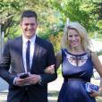 Michael Bublé et sa femme Luisana Lopilato, enceinte, au mariage d'un couple d'amis à Vancouver le 12 août 2013.