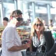 Kate Moss et son mari Jamie Hince à l'aéroport d'Heathrow. Londres, le 31 août 2013.