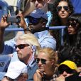 Naomi Campbell, avec devant elle Sir Richard Branson, dans les gradins du court Arthur-Ashe pour la demi-finale Nadal-Gasquet de l'US Open 2013. Rafael Nadal a privé Richard Gasquet de finale à l'US Open en le battant (6-4, 7-6, 6-2) à New York le 7 septembre 2013.
