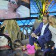 """Cindy aus Marzahn, Pamela Anderson et Oliver Pocher dans l'émission """"Big Brother"""" à Berlin le 24 septembre 2013."""