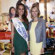 Hinarani de Longeaux, première dauphine de Miss France 2013, et Sylvie Tellier au salon Top Resa à Paris, Porte de Versailles, le 25 septembre 2013.