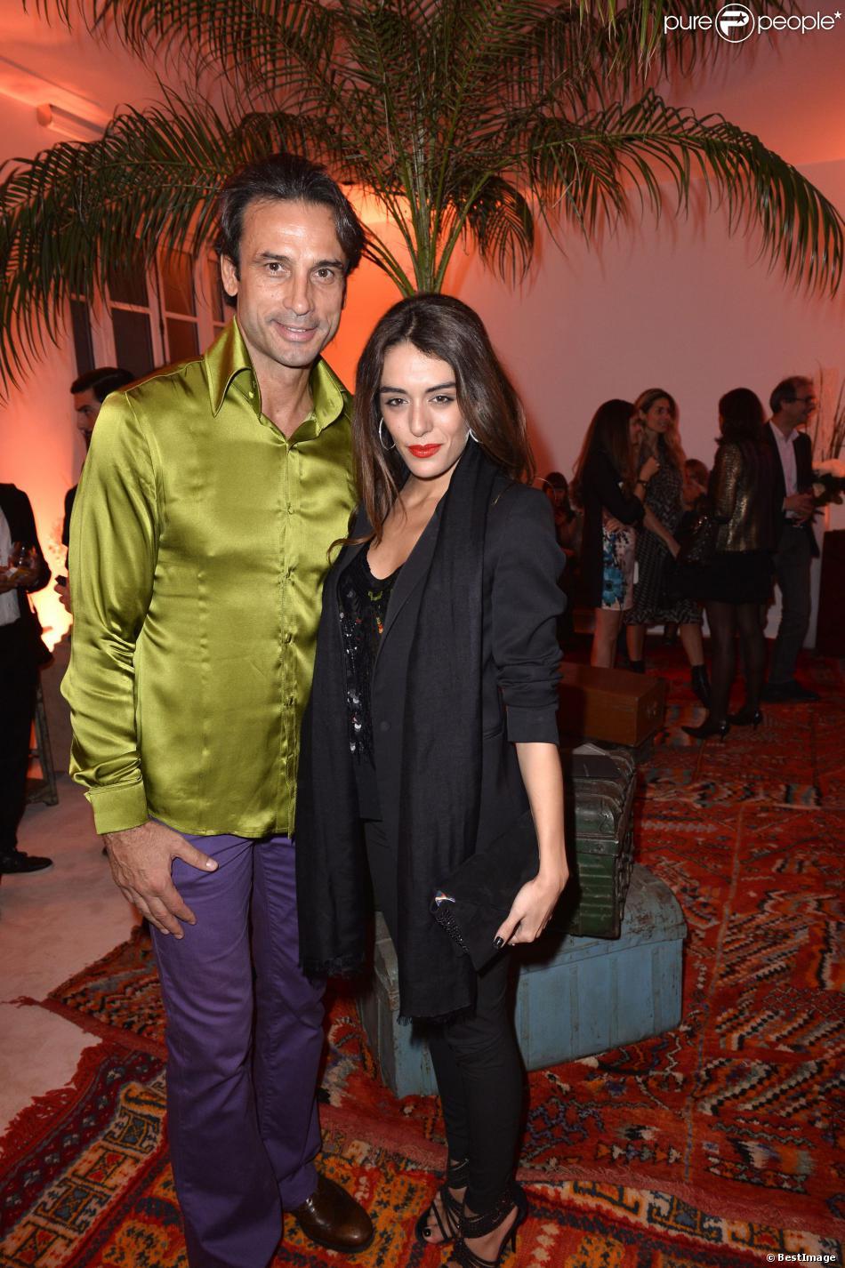 Adanan Taletovic et Sofia Essaidi au premier défilé de mode prêt à porter printemps-été 2014 du créateur Adnan Taletovic à Paris le 26 septembre 2013.