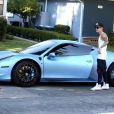 Le jeune Justin Bieber avec sa Ferrari à Los Angeles, le 15 août 2013.