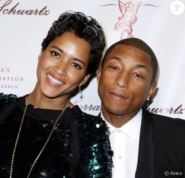 Helen Lasichanh et son mari Pharrell Williams assistent à l'Angel Ball de la fondation Gabrielle's Ange, au restaurant Cipriani. New York, le 29 octobre 2013.