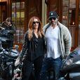 Poppy Montgomery et Shawn Sanford quittent le restaurant La Fontaine de Mars, dans le 7e arrondissement. Paris, le 9 décembre 2013.