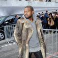 Kanye West arrive à la Halle Freyssinet pour assister au défilé Givenchy automne-hiver 2014-2015. Paris, le 17 janvier 2014.