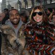 Kanye West et Carine Roitfeld assistent au défilé Givenchy automne-hiver 2014-2015, à la Halle Freyssinet. Paris, le 17 janvier 2014.