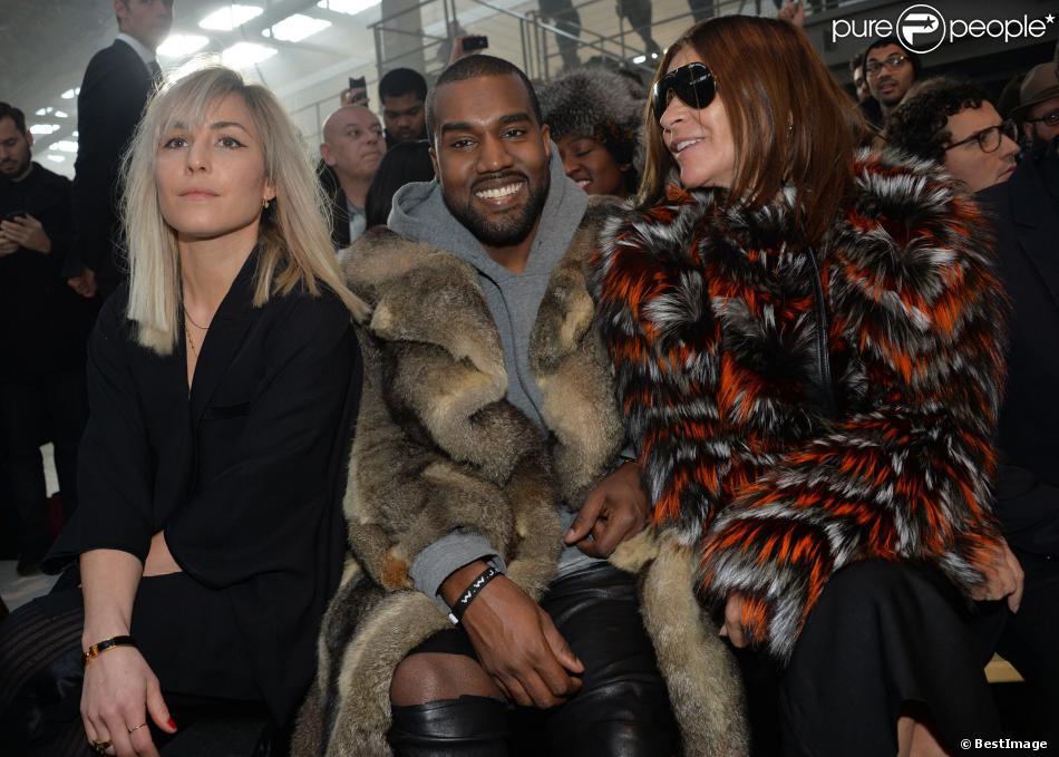 Noomi Rapace, Kanye West et Carine Roitfeld assistent au défilé Givenchy automne-hiver 2014-2015, à la Halle Freyssinet. Paris, le 17 janvier 2014.