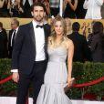 Kaley Cuoco et son mari Ryan Sweeting lors de la 20e cérémonie des Screen Actors Guild Awards au Shrine Exposition Center de Los Angeles, le 18 janvier 2014.