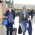 Ronan Keating et sa petite amie Storm Uechtritz à l'aéroport de Londres, le 20 janvier 2014.