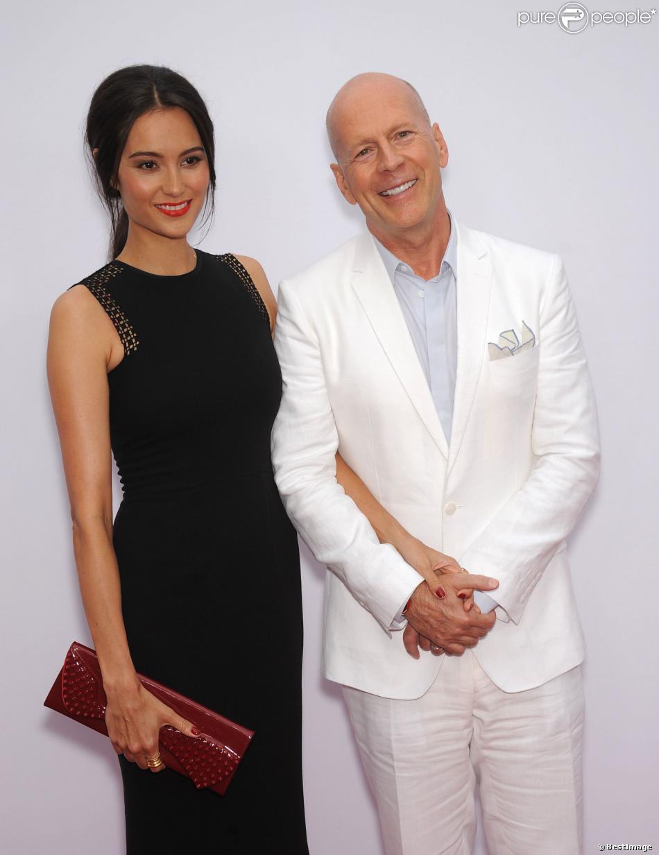 """Bruce Willis et Emma Heming - lors d'une projection du film """"Red 2"""" à Westwood le 11 juillet 2013."""