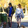 Exclusif - Leighton Meester et son fiance Adam Brody promènent leurs chiens à Los Angeles, le 22 decembre 2013.