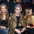 Malgosia Bela, Catherine Deneuve, Joséphine de la Baume - Défilé de la collection Natalia pour Etam à la Bourse du Commerce à Paris, le 25 février 2014.