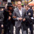 Naomi Campbell et Nigel Baker arrivent à l'entrée du NASDAQ pour sonner la fin de séance. New York, le 5 mars 2014.