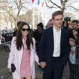 """""""Elizabeth Olsen et Boyd Holbrook lors du défilé Miu Miu à Paris pendant la Fashion Week le 5 mars 2014"""""""