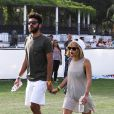 Noah Becker et Zoë Kravitz, main dans la main lors du festival de Coachella. Indio, le 12 avril 2014.