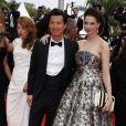"""Frédéric Chau et Frédérique Bel - Montée des marches du film """"Jimmy's Hall"""" lors du 67e Festival du film de Cannes le 22 mai 2014"""