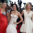 """Marion Dumas, Karine Lima et Eleonore Boccara, toutes les trois habillées par Christophe Guillarmé, à la montée des marches du film """"Sils Maria"""" lors du 67e Festival du film de Cannes le 23 mai 2014."""