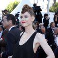 """Kiesa Rae Ellestad à la montée des marches du film """"Sils Maria"""" lors du 67e Festival du film de Cannes le 23 mai 2014."""