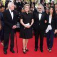 """Catherine Deneuve et John Boorman à la montée des marches du film """"Sils Maria"""" lors du 67e Festival du film de Cannes le 23 mai 2014."""