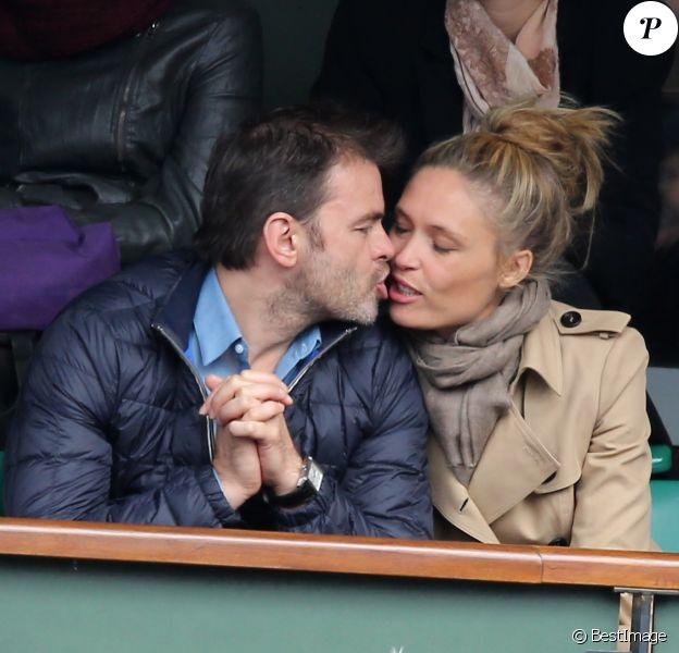 Clovis Cornillac et sa femme Lilou Fogli assistent aux Internationaux de France de tennis de Roland-Garros à Paris, le 27 mai 2014.