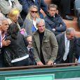 Raymond Domenech et sa compagne Estelle Denis assistent aux Internationaux de France de tennis de Roland Garros à Paris, le 27 mai 2014.