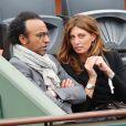 Manu Katché et sa compagne Laurence - People aux Internationaux de France de tennis de Roland Garros à Paris, le 27 mai 2014, pendant le match de Gaël Monfils. .