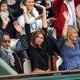 Manu Katché, sa compagne Laurence et Isabelle Camus aux Internationaux de France de tennis de Roland Garros à Paris, le 27 mai 2014,