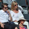 François Baroin et sa compagne Michèle Laroque aux Internationaux de France de tennis de Roland Garros à Paris, le 6 juin 2014