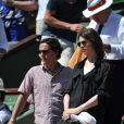 Charlotte Gainsbourg et Yvan Attal aux Internationaux de France de tennis de Roland Garros à Paris, le 6 juin 2014