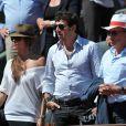 Patrick Bruel et sa compagne Caroline, Michel Drucker aux Internationaux de France de tennis de Roland Garros à Paris, le 6 juin 2014