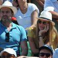 Clovis Cornillac et sa femme Lilou Fogli aux Internationaux de France de tennis de Roland Garros à Paris, le 6 juin 2014