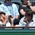 Patrick Bruel et sa compagne Caroline aux Internationaux de France de tennis de Roland Garros à Paris, le 6 juin 2014