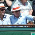 Patrick Bruel et Michel Drucker aux Internationaux de France de tennis de Roland Garros à Paris, le 6 juin 2014