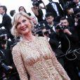 Michèle Laroque (Robe Zuhair Murad, bague et boucles d'oreilles Montblanc Princesse Grace de Monaco Pétale Entrelacés en or rose et diamants) à Cannes le 16 mai 2014.
