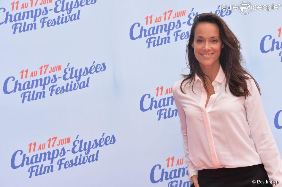 Karine Lima lors du photocall de la cérémonie de clôture du 3e Champs-Elysées Film Festival au Publicis à Paris, le 17 juin 2014